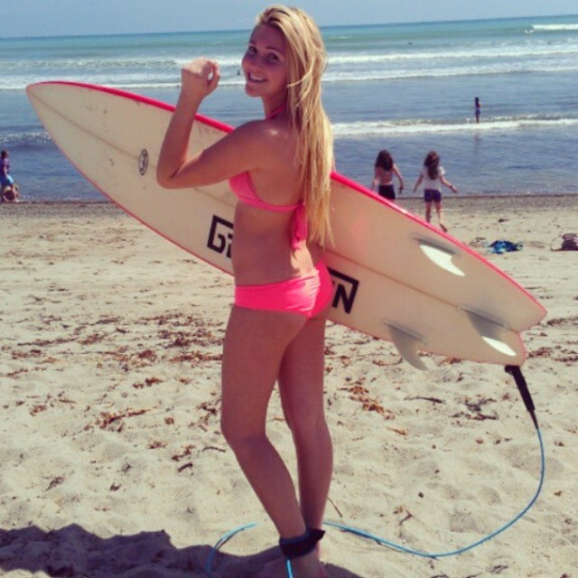 Saige getting ready to paddle out